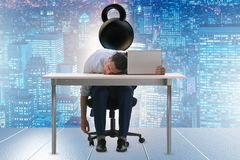 Employee with burden of work. The employee with burden of work royalty free stock image