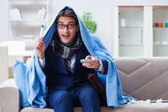 The employee businessman watching tv while being sick with flu. Employee businessman watching tv while being sick with flu Royalty Free Stock Photo