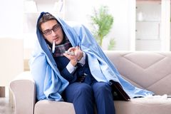 The employee businessman watching tv while being sick with flu. Employee businessman watching tv while being sick with flu Royalty Free Stock Photos