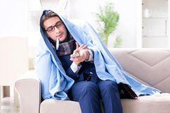 The employee businessman watching tv while being sick with flu. Employee businessman watching tv while being sick with flu Stock Image