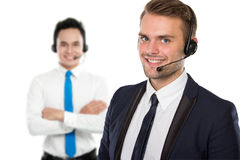 Employee of call center with a headset on Stock Photos