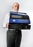 An employee carries folders Stock Photos