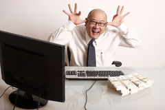 Employee with cash Royalty Free Stock Photos