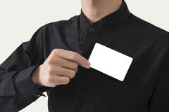 Employee catch blank business card in pocket for mockup template. Logo branding background royalty free stock image