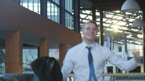 Employee Celebrating Success. Male Businessman Rejoicing and jumping with happiness stock video footage