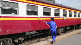 An employee cleans a railway passenger car stock photo