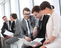 Employee with colleagues before the briefing. Employee of a company with colleagues to discuss working papers royalty free stock photos