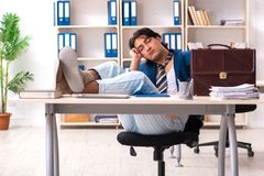 The employee coming to work straight from bed. Employee coming to work straight from bed stock photography