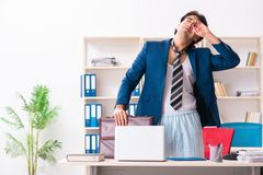 The employee coming to work straight from bed. Employee coming to work straight from bed stock photos