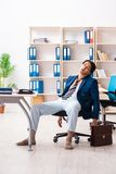 The employee coming to work straight from bed. Employee coming to work straight from bed stock images