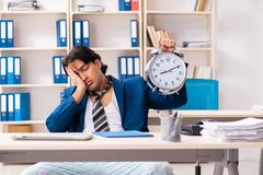 The employee coming to work straight from bed. Employee coming to work straight from bed stock image