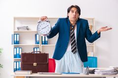 The employee coming to work straight from bed. Employee coming to work straight from bed royalty free stock photo