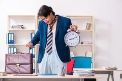 Employee coming to work straight from bed. The employee coming to work straight from bed stock images