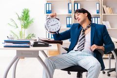 Employee coming to work straight from bed stock photography