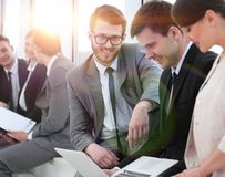 Employee with colleagues before the briefing. Employee of a company with colleagues to discuss working papers stock photos