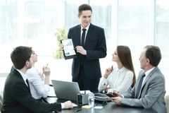 Employee of the company providing new ideas of business development at a business meeting. Photo with copy space Stock Images