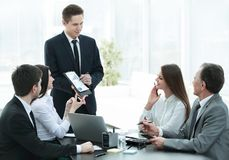 Employee of the company providing new ideas of business development at a business meeting stock photo