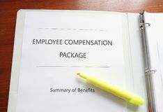 Employee Compensation Package. Employee Compensation and benefits package on a desk with highlighter Stock Image