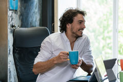 Employee in creative industries having coffee and talk Stock Photo
