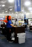 Employee Dressed in Native American Head dress for Halloween at BestBuy Electroics Store in Tulsa Oklahoma 10-12-2017 royalty free stock image