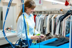Employee in dry-cleaning company working royalty free stock photos