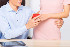 Employee embraces a woman while taking the cup Stock Photos