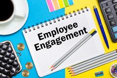 Employee Engagement notes in the notebook on the Desk of a busin. Essman in office. Business concept Employee Engagement Stock Image