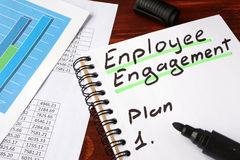 Employee engagement. Employee engagement written in a notebook and marker stock photo