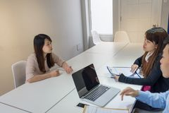 Employee explain to boss about the problem. Employee explain to her boss about the big problem royalty free stock photo