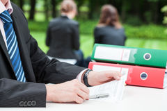 Employee with file binders Royalty Free Stock Photo