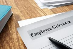 Employee Grievance form on an office desk