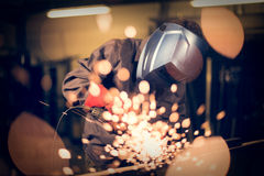 Employee grinding steel with sparks Stock Images