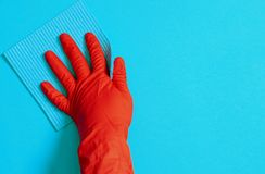 Free Employee Hand In Rubber Protective Glove With Micro Fiber Cloth Wiping Wall From Dust. Commercial Cleaning Company Concept Royalty Free Stock Photography - 165646107