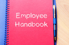 Employee handbook text concept on notebook royalty free stock photo