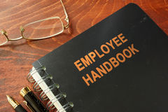 Employee handbook. On a wooden table and glasses Royalty Free Stock Photography