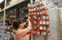 Employee in hardware store. An employee is arranging products in an OBI Do-it-yourself (DIY) hardware store Stock Photo