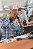 Employee having stretch while phoning Royalty Free Stock Images