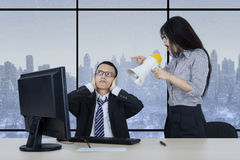 Employee with her manager in winter background Stock Photo