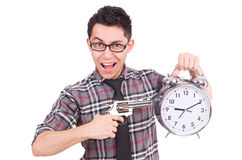 Employee holding alarm clock and weapon isolated Stock Photo