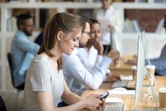 Employee holding smartphone using gadget surfing internet stock photo