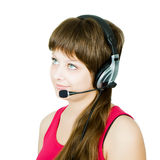 Employee hotline. The girl in headphones with a microphone on an isolated white background Stock Photos