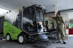 Employee hygiene solo city government was taking care of garbage sweeper car in City Hall solo Central Java Indonesia Stock Images