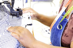 Employee at industrial sewing machine Stock Photography