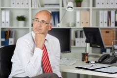 Employee looking to side in thought Royalty Free Stock Photo