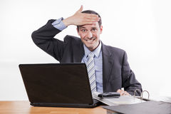 Employee makes stupid gesture Royalty Free Stock Photo