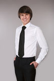 Employee man in white shirt with black tie keeping hands in pock Royalty Free Stock Images