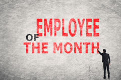 Employee of the Month. Asian businessman write text on wall, Employee of the Month Stock Photography
