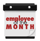 Employee of the Month Calendar Top Performing Worker Award. Employee of the Month words on a wall calendar or sign recognizing the top performing worker at a Royalty Free Stock Photos