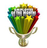 Employee of the Month Gold Trophy Award Top Performer Recognitio. Employee of the Month words and colorful stars in a golden trophy awarded to the top performing Stock Image