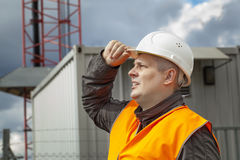 Employee near the gsm tower. Before the rain Royalty Free Stock Photography